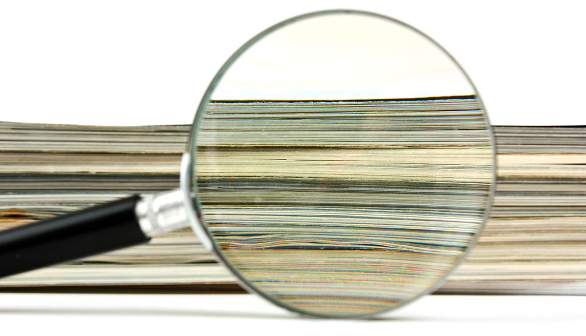Magnifying glass and magazines