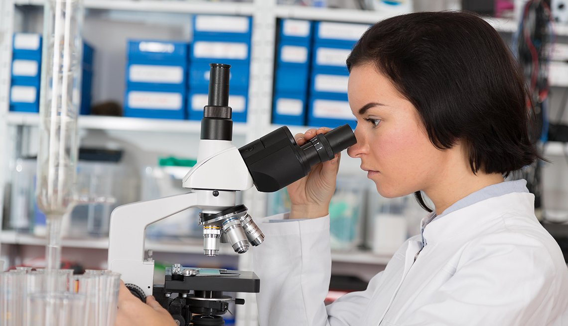 Woman using microscope