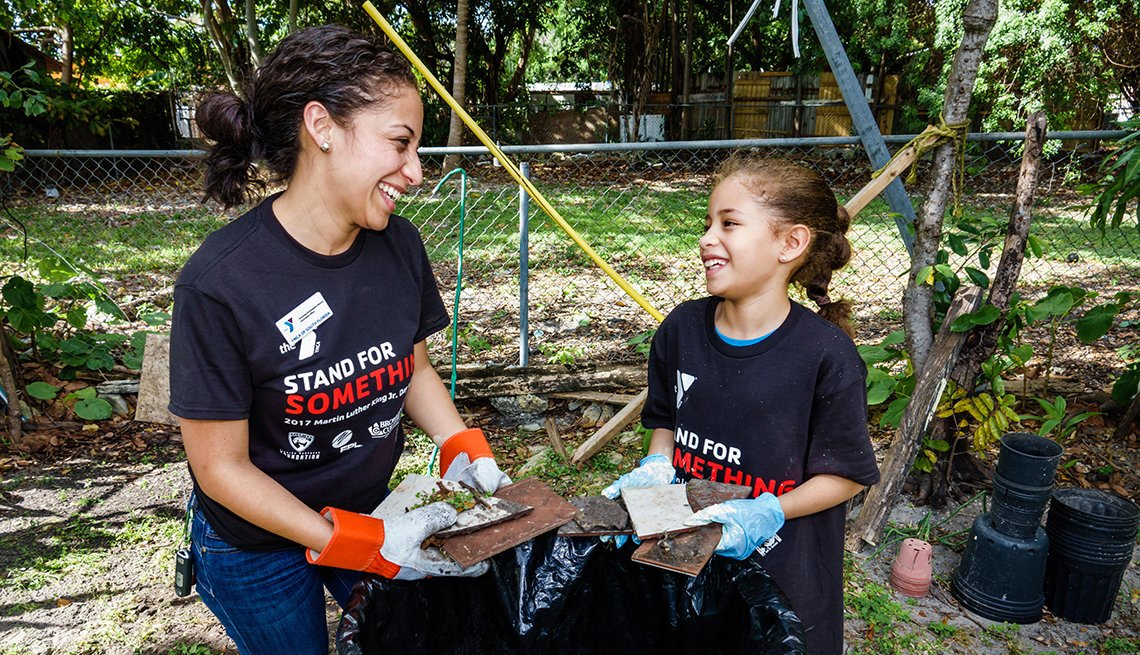 mother and daughter community volunteers at work