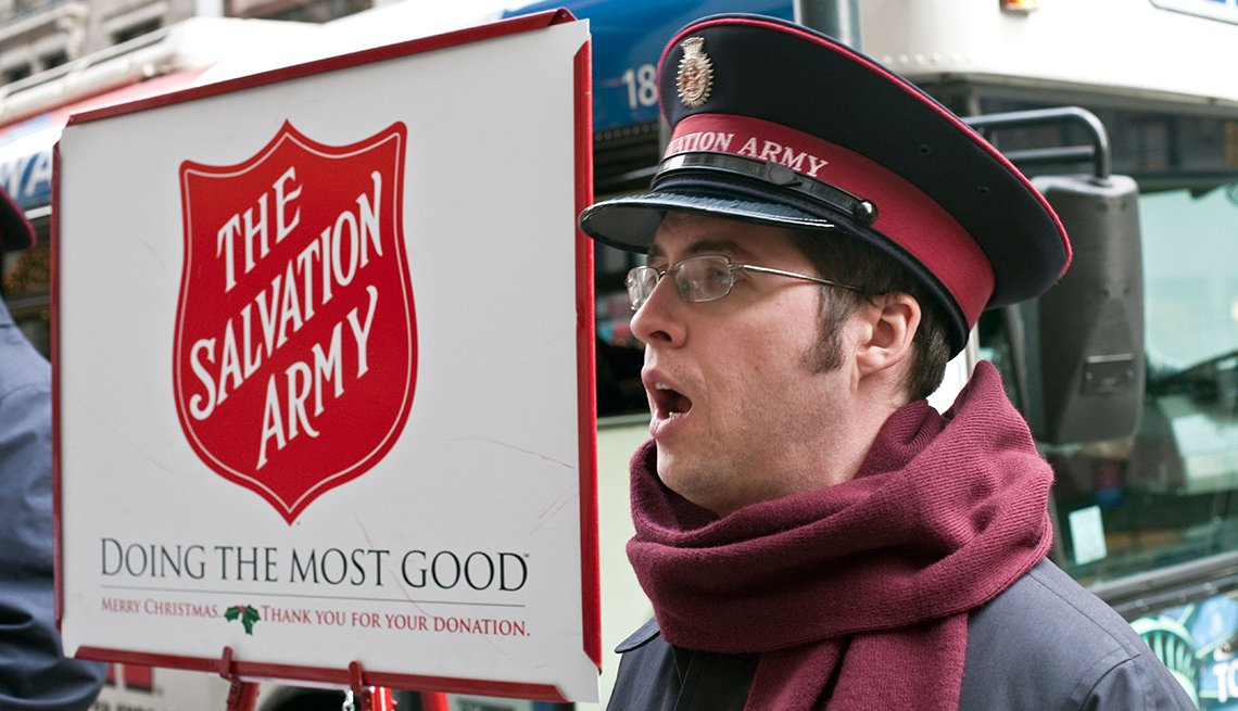 Salvation Army officer singing for donations