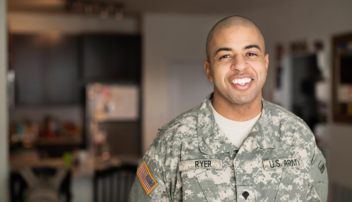 Man in a military uniform smiling at the camera