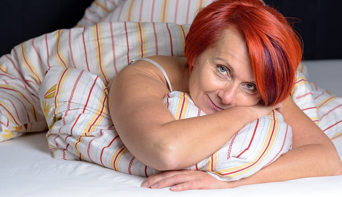 Red head woman in bed