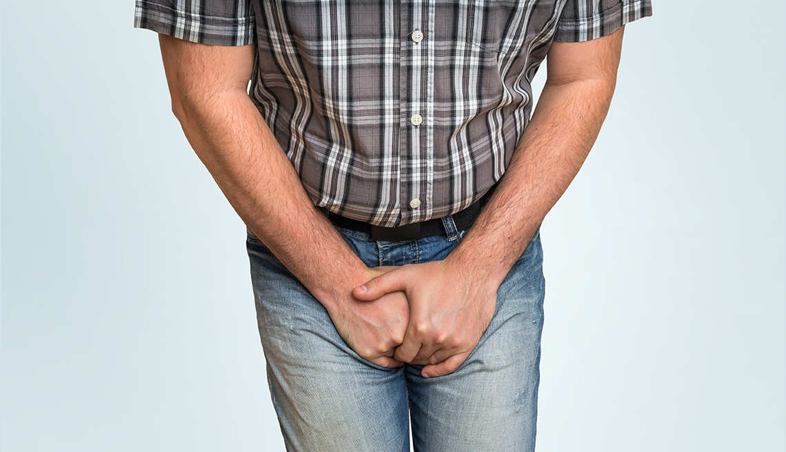 man with hands holding his crotch because he needs to pee