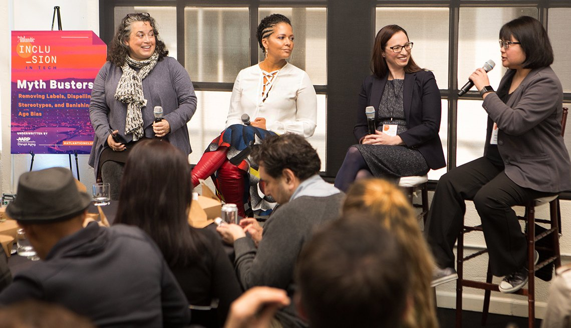 4 women speak during a conference