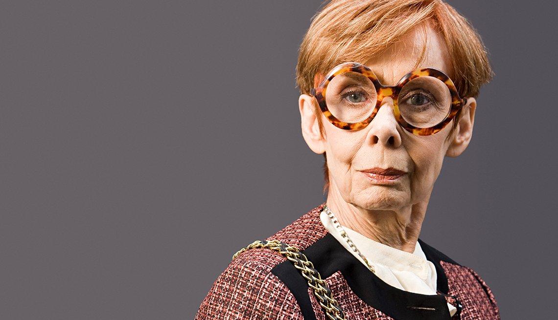 Older woman wearing large eyeglasses and fashionable clothing