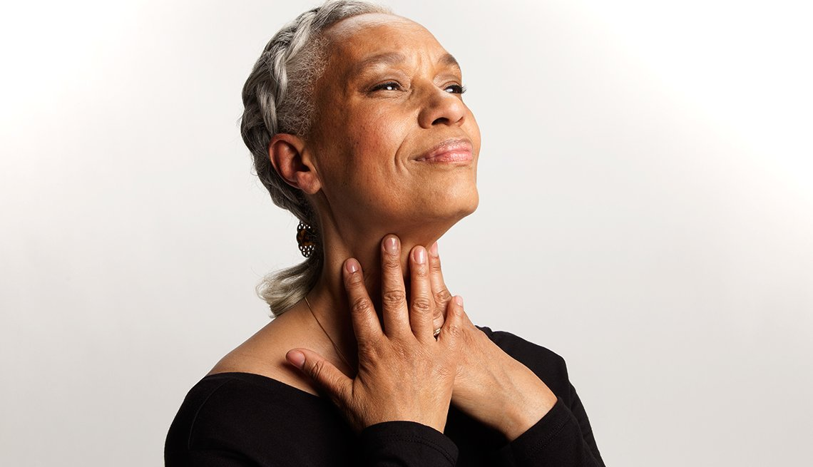 Woman with hands on her neck doing Face Yoga