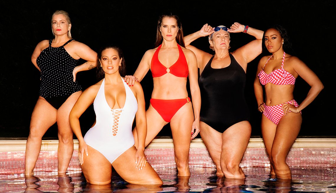 Five women standing in water wearing swimsuits. Includes nurse practitioner Katie Duke, model Ashley Graham, model Brooke Shields, professional swimmer Pat Gallant-Charette and reality TV star Angela Simmons