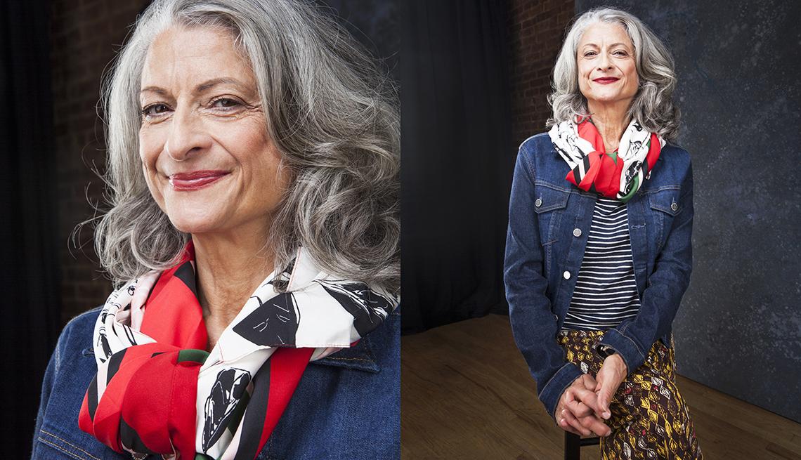item 2 of Gallery image - Janis Dardaris wearing a denim jacket, red silk scarf, and gold printed skirt
