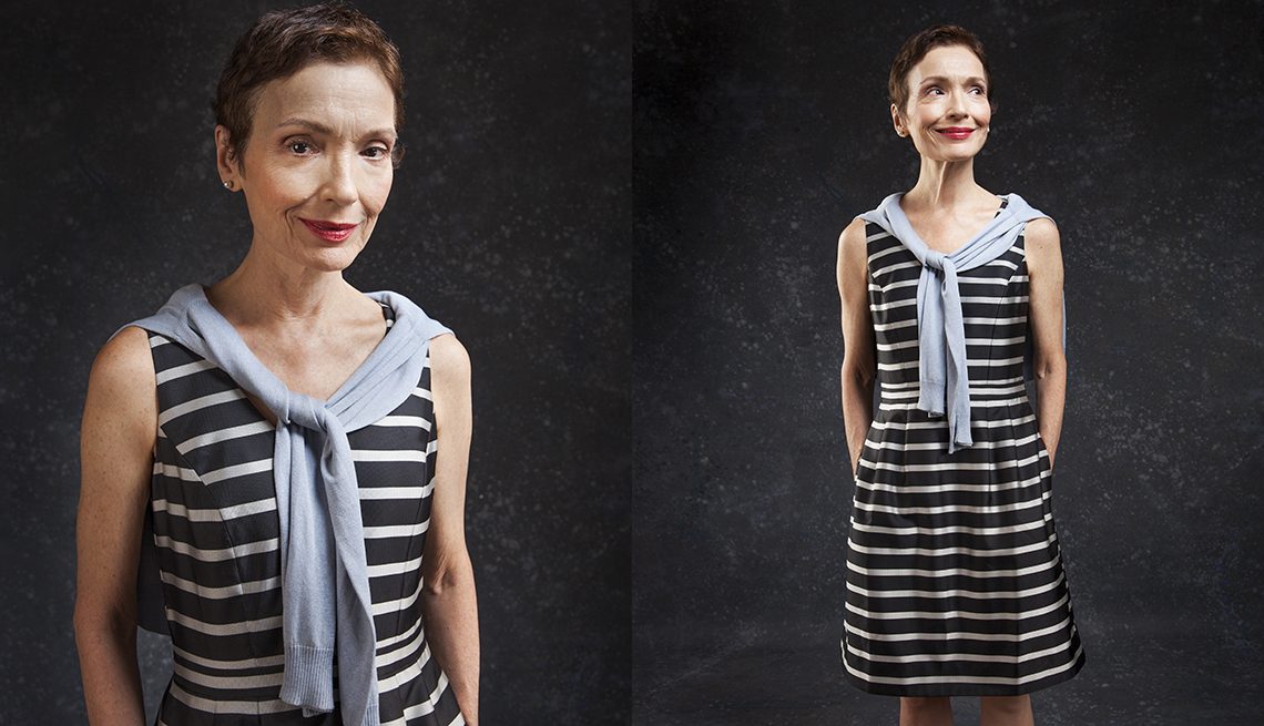 item 6 of Gallery image - Susanna Bianchi wearing a black and white striped dress with a blue sweater around her shoulders