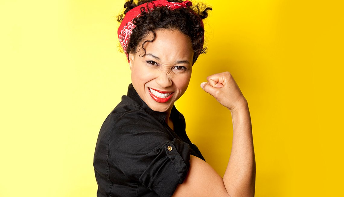 Recreation of We Can Do It Image. Woman smiling and flexing bicep
