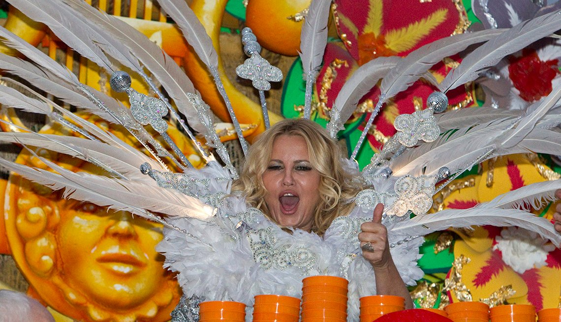 Actress Jennifer Coolidge rides on a float during Mardi Gras