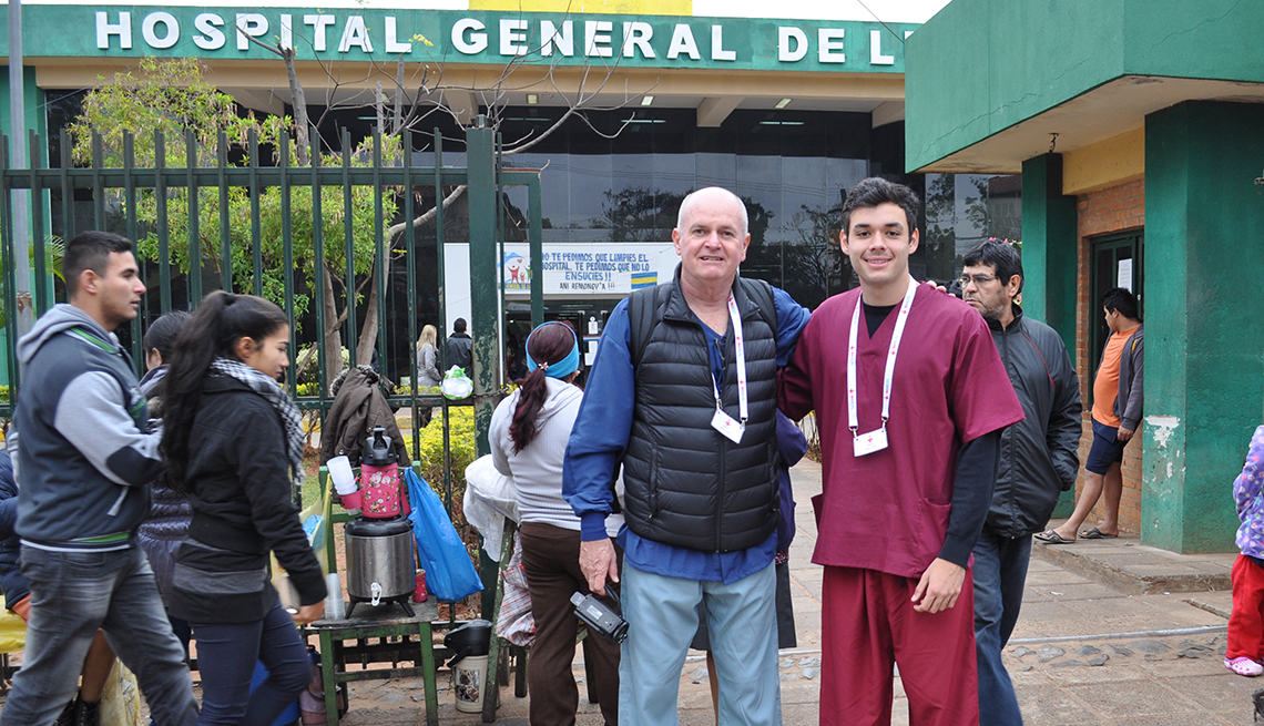 Jeff and Max stand outside a hospital in Paraguay.