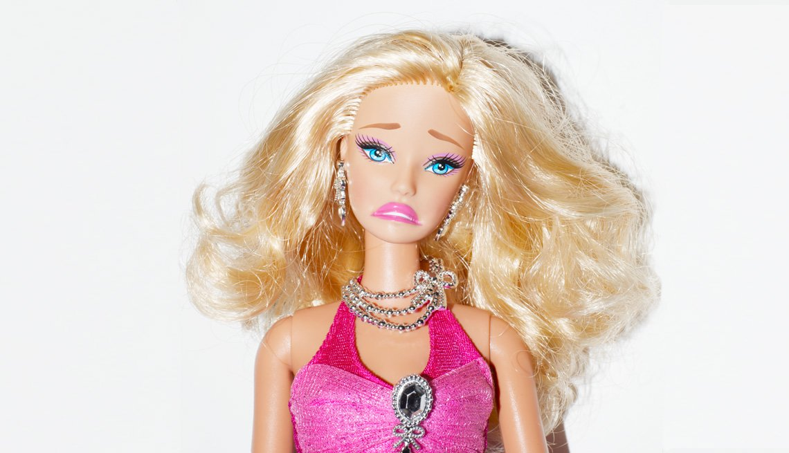 Barbie-type doll with a frown on her face