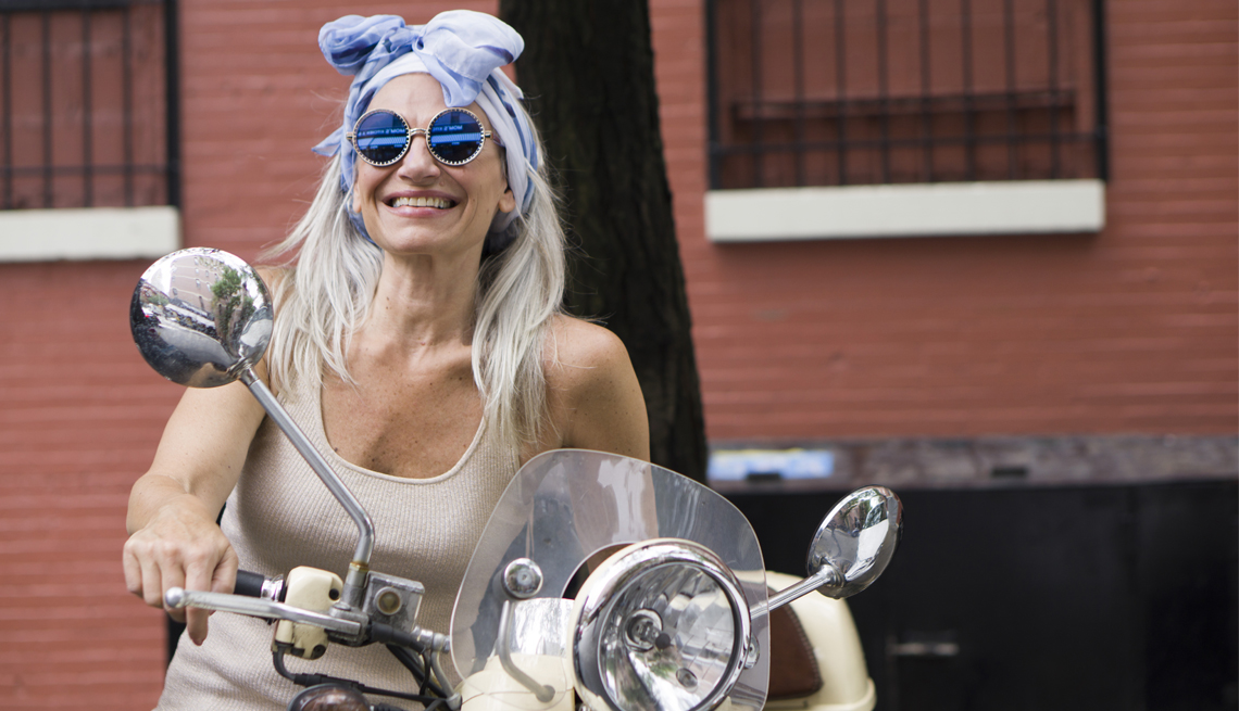 Dian Griesel sitting on a motorcycle