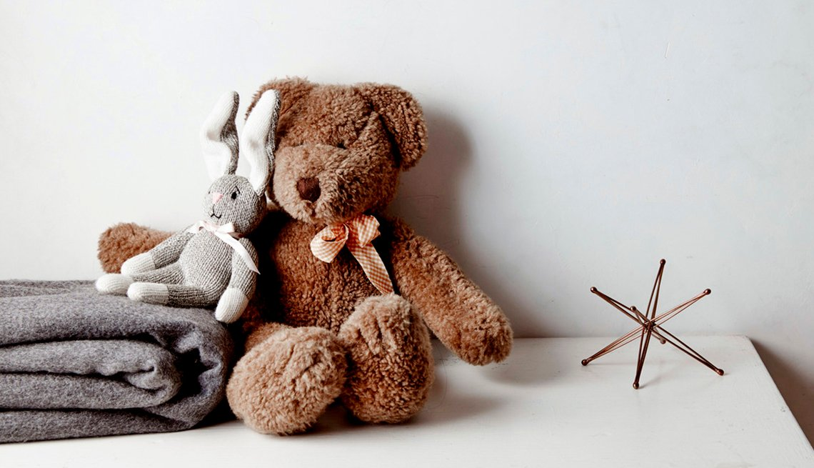 A bear and rabbit stuffed animal on a shelf