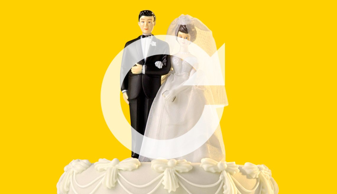 A man and wife wedding cake topper with a redo symbol overlaid on top