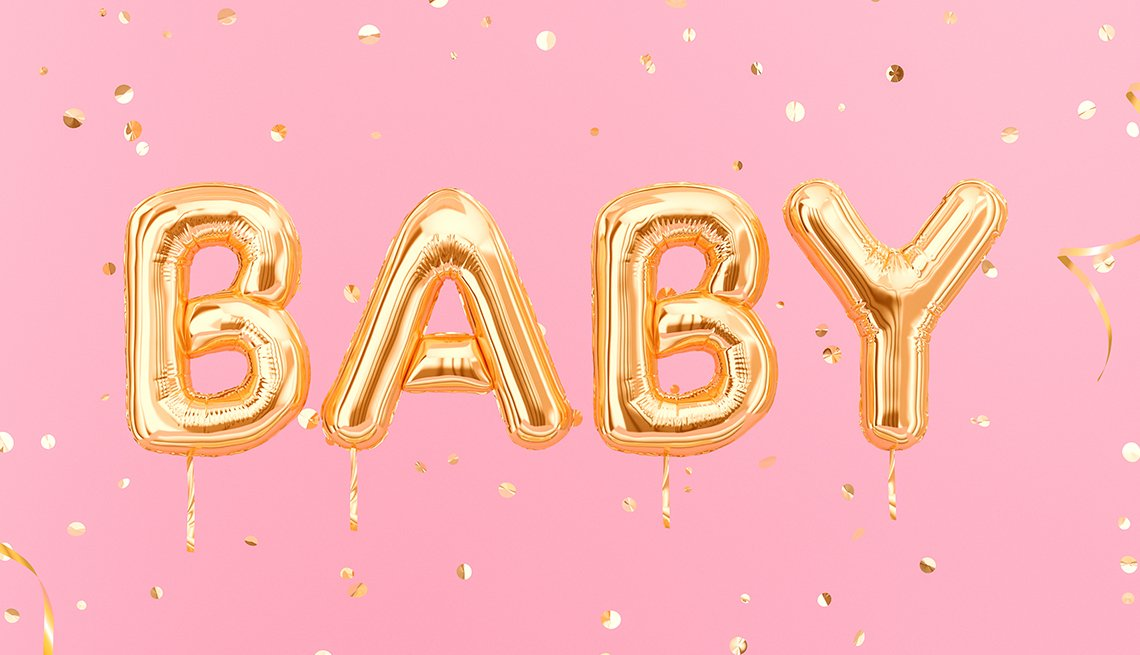 Word baby spelled out in gold balloons