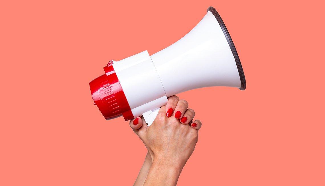 Woman's hands holding a megaphone