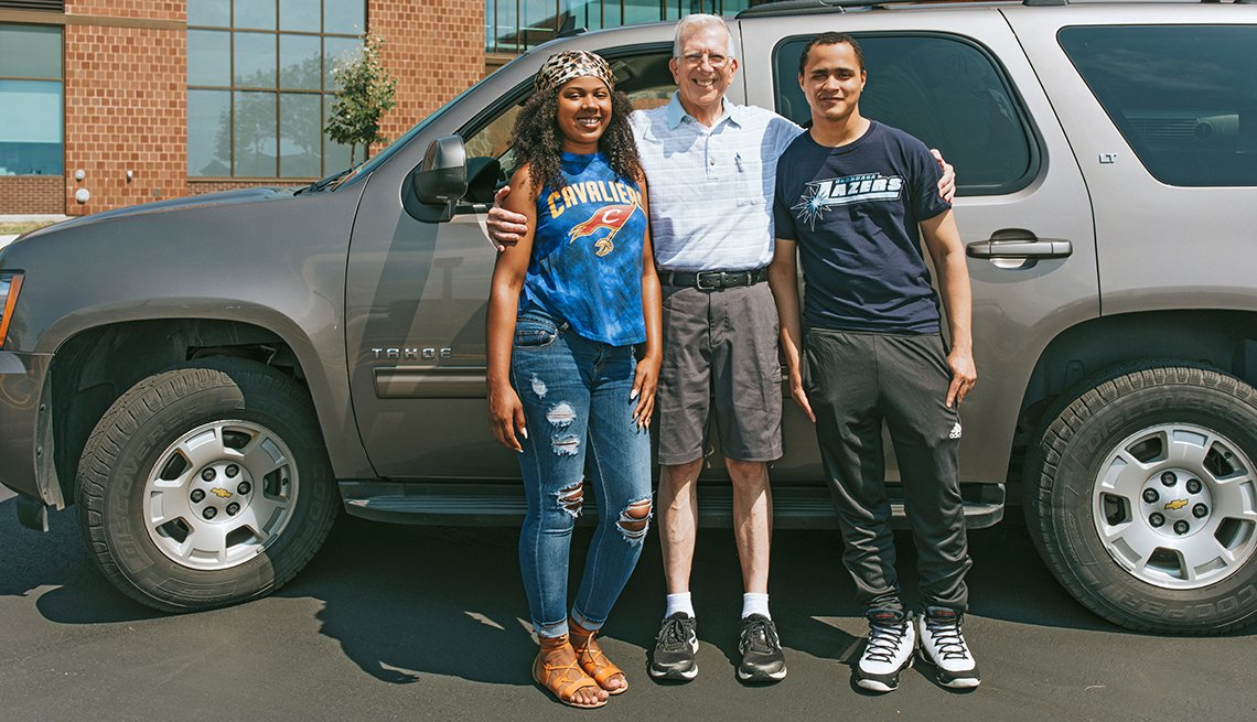 Paul Goetchius with students Tatiana Lee (left) and Vincent Anderson (right), arrive at Genesee Community College in Batavia, NY
