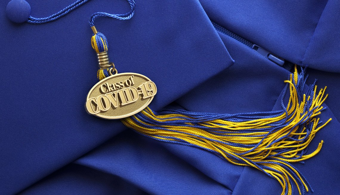 A graduation tassel with a medallion that says Class of C O V I D 19