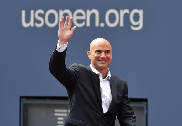 Former tennis star Andre Agassi of the US waves as he arrives to be named the 2012 inductee into the US Open Court of Champions