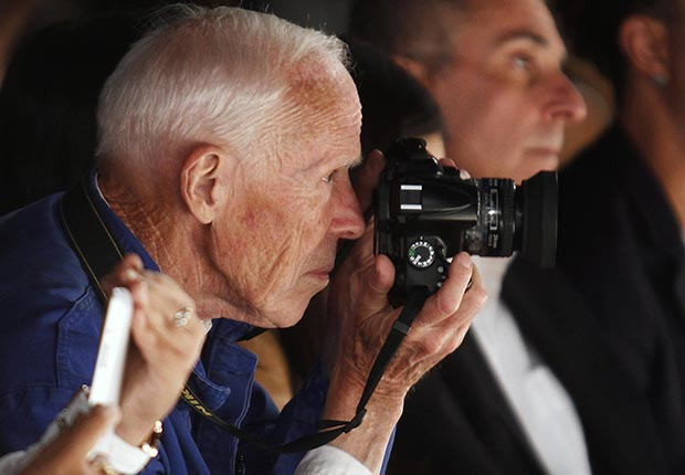 New York Times photographer Bill Cunningham takes photos during the Naeem Khan Spring/Summer 2013 collection show at New York Fashion Week September 11, 2012