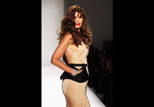 Carol Alt, age 51, models clothes designed by Norisol Ferrari during the Fashion Week 2012. Alt was a top model in the 1980s appearing on more than 500 magazine covers including the Sports Illustrated swimsuit issue.