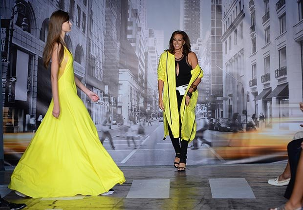 Donna Karan appeared at the end of her Spring/Summer Collection 2013 show in a stoplight yellow coat from the collection