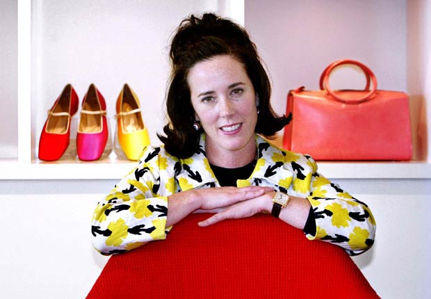 Kate Spade pose with handbags and shoes from her next collection in New York, Thursday