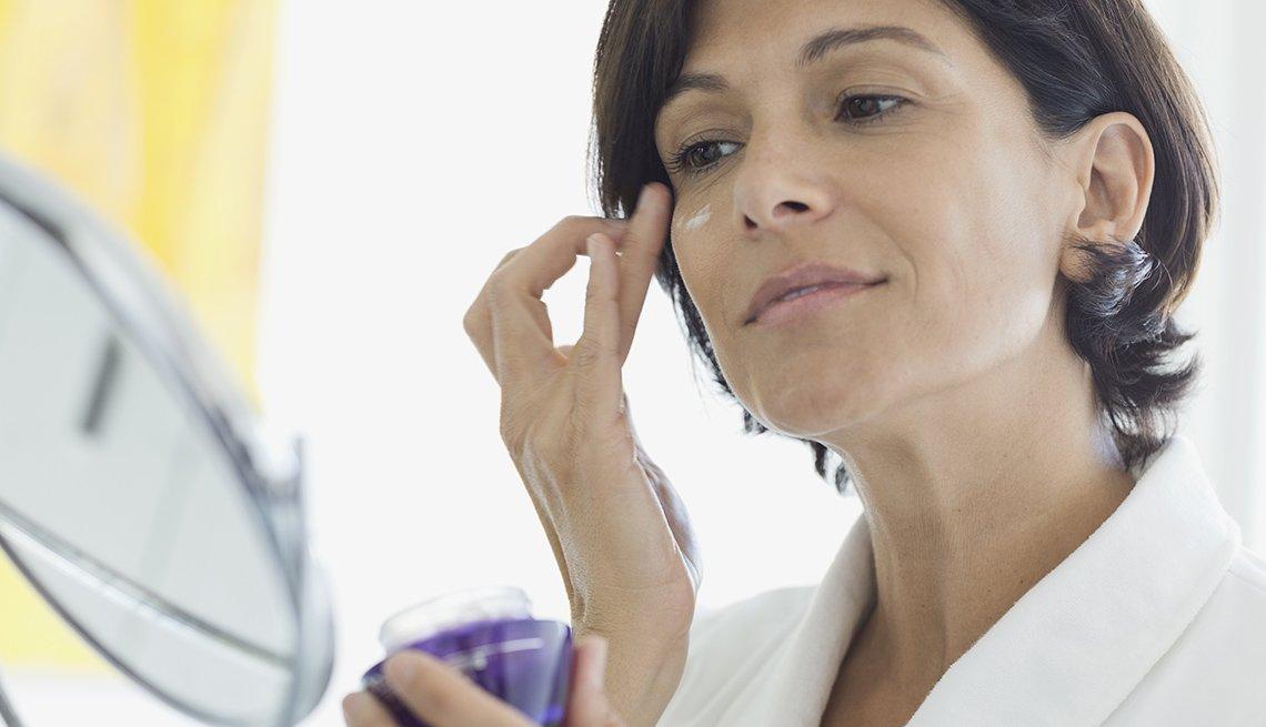 Woman Applying Makeup, Moisturizer, Mirror, Bathroom, Look Younger