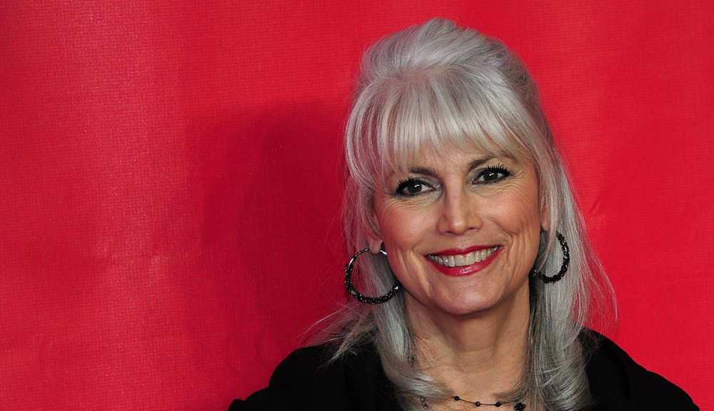 6 steps to silver grey hair smiling woman grey hair red background emmylou harris singer going grey solutioingenieria Image collections