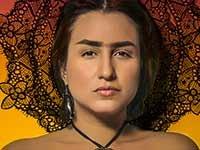 Rebecca G. Torres personificando a Frida Kahlo