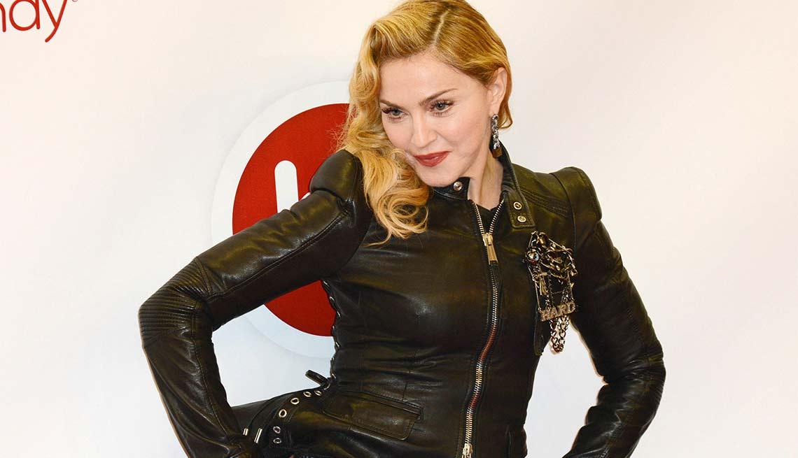Madonna sports a black leather jacket