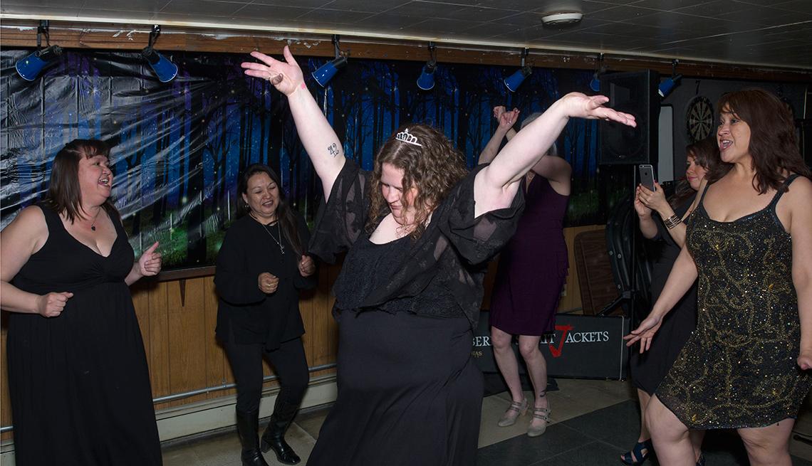Teenage girls dancing at prom