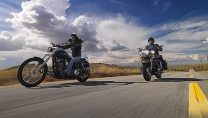 Man and woman riding motorcycles on an open road near Palmdale California