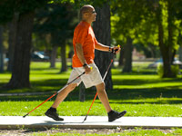 Man walking with poles for senior mobility
