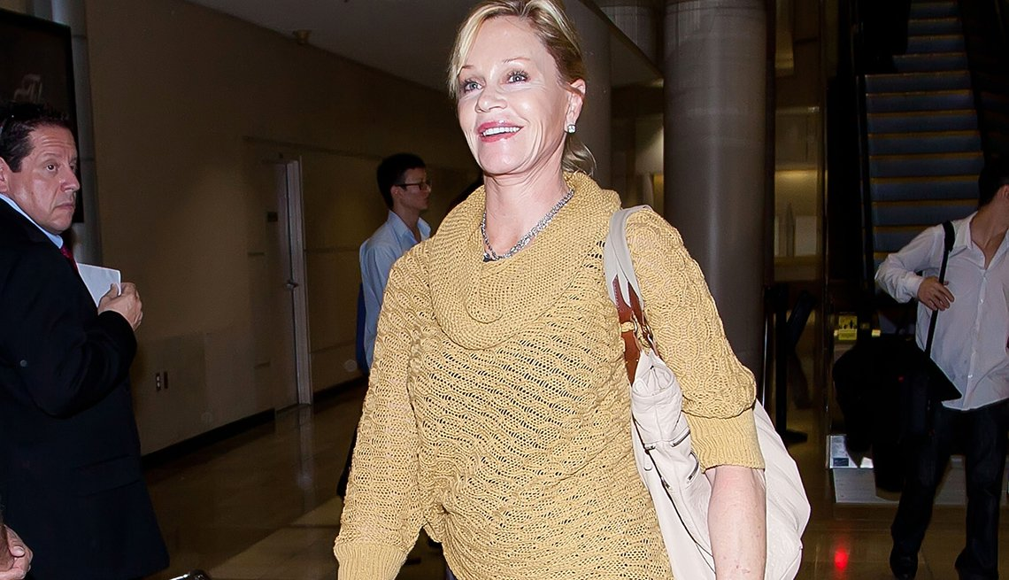 item 6, Gallery image. Actress Melanie Griffith wearing a cowl-neck sweater.