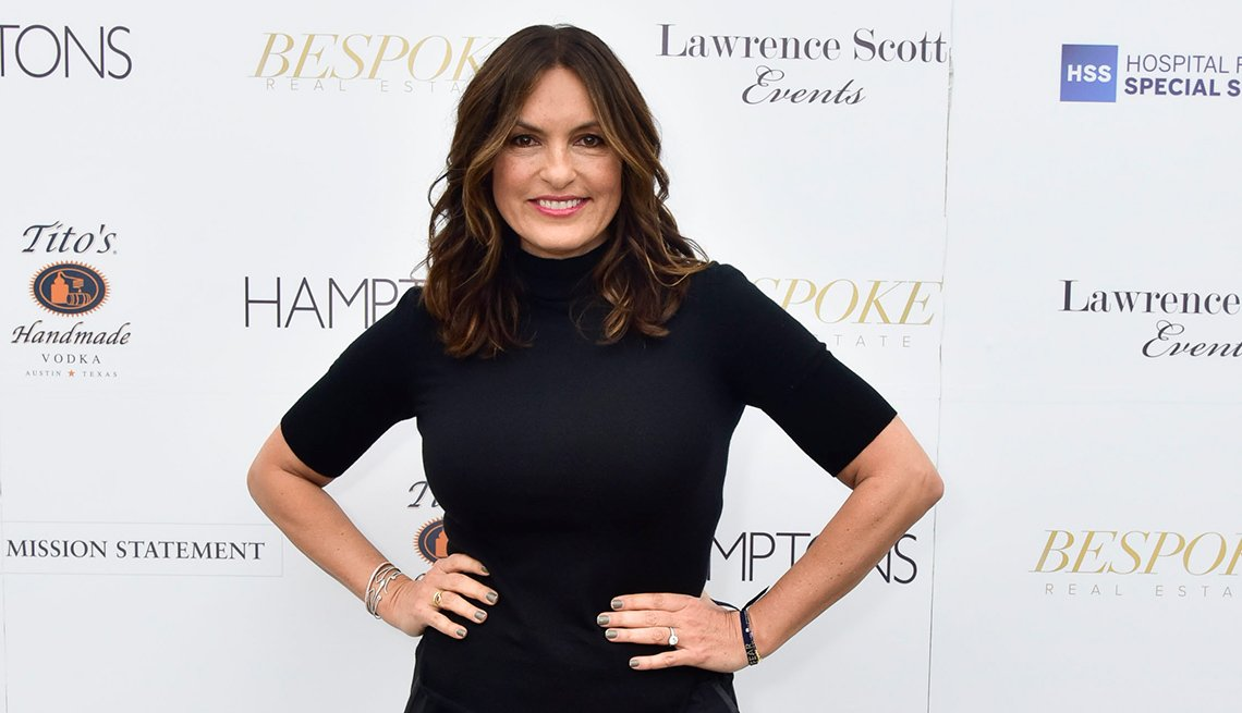 item 3 of Gallery image -  Mariska Hargitay wearing a black ribbed turtleneck