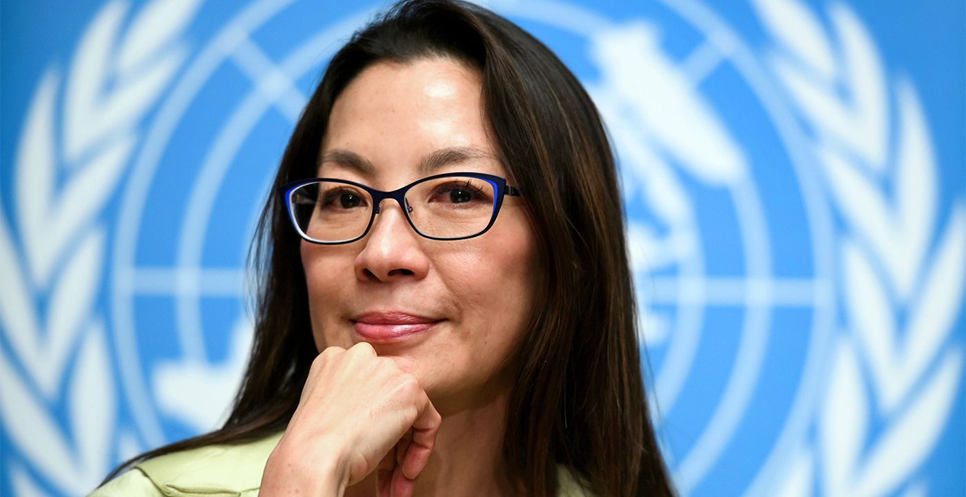 item 6 of Gallery image - Actress Michelle Yeoh wearing blue eyeglasses