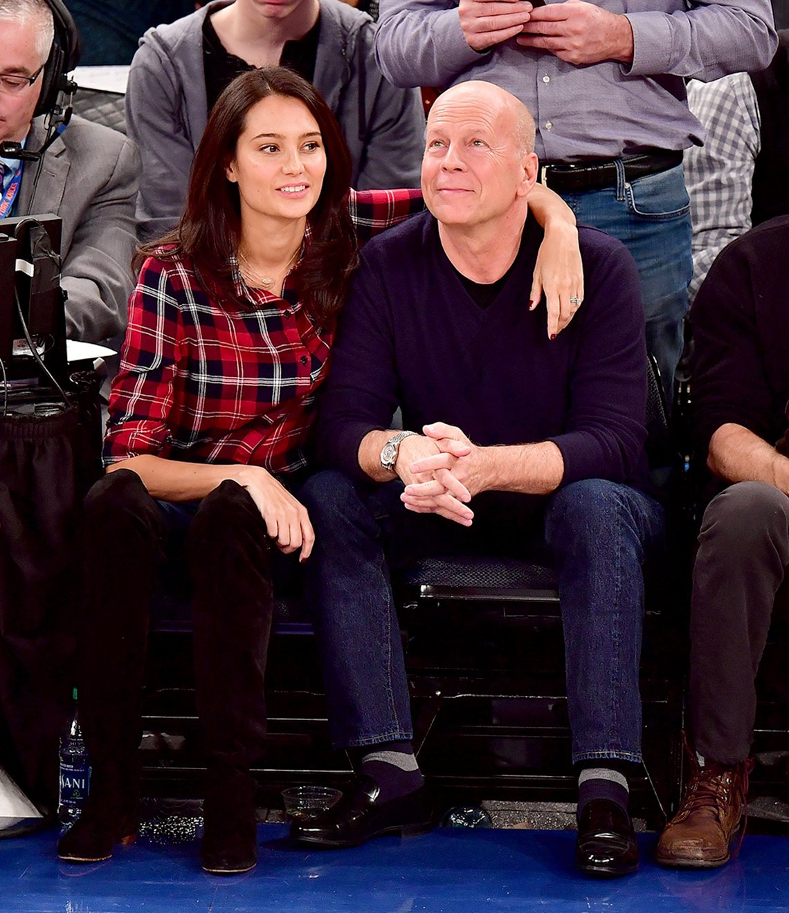 item 5, Gallery image. Emma Heming Willis and Bruce Willis catch a basketball game in 2017.