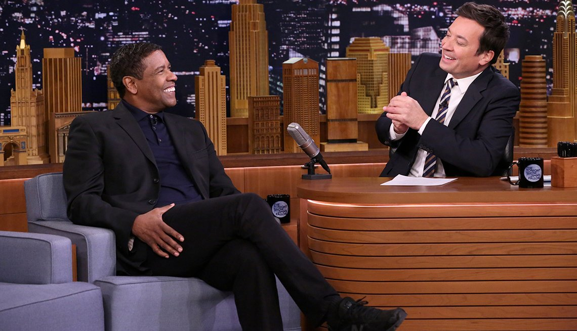item 1, Gallery image. Actor Denzel Washington looks sharp but casual during an interview with host Jimmy Fallon in 2017.
