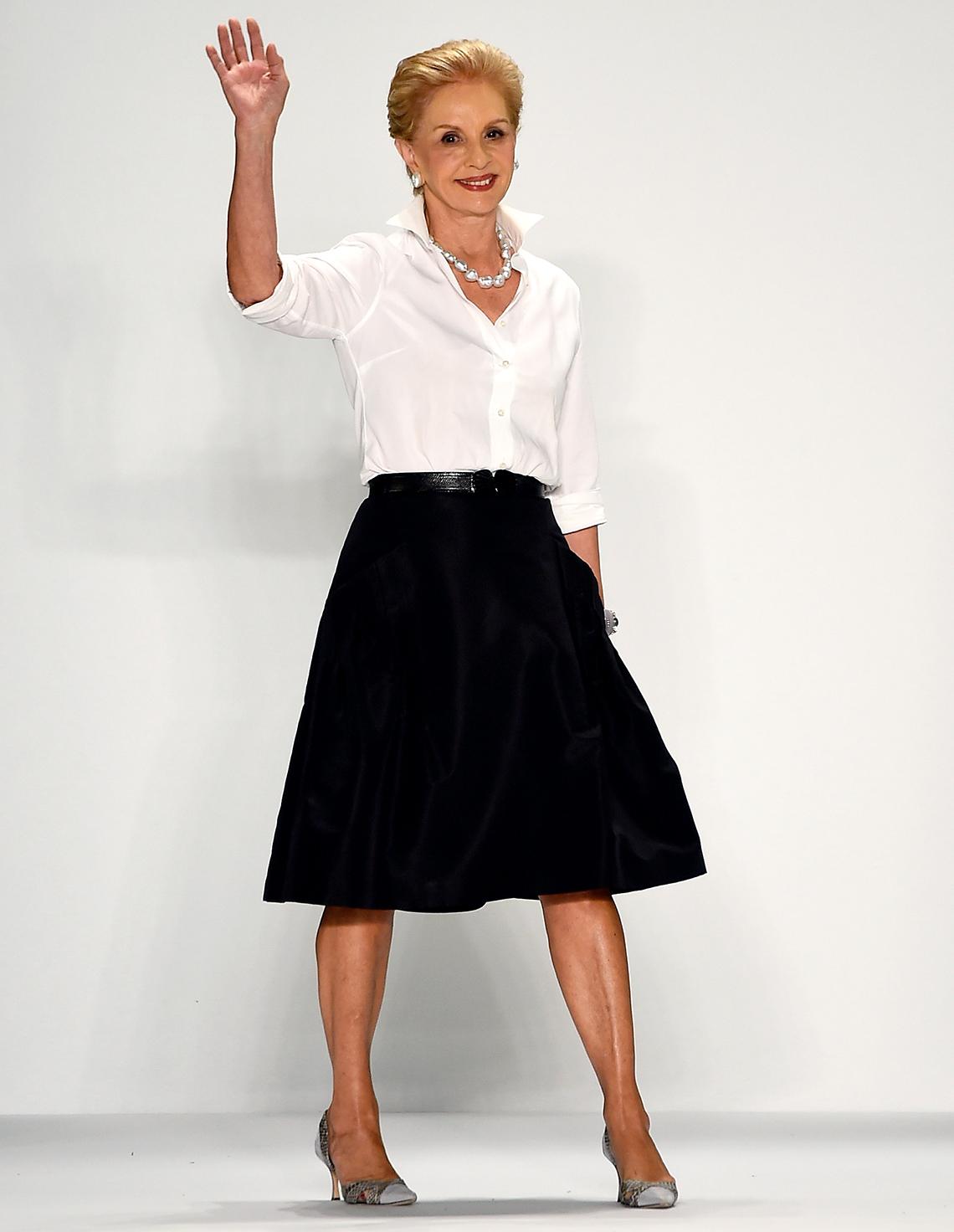 carolina herrera walks runway while waving at audience