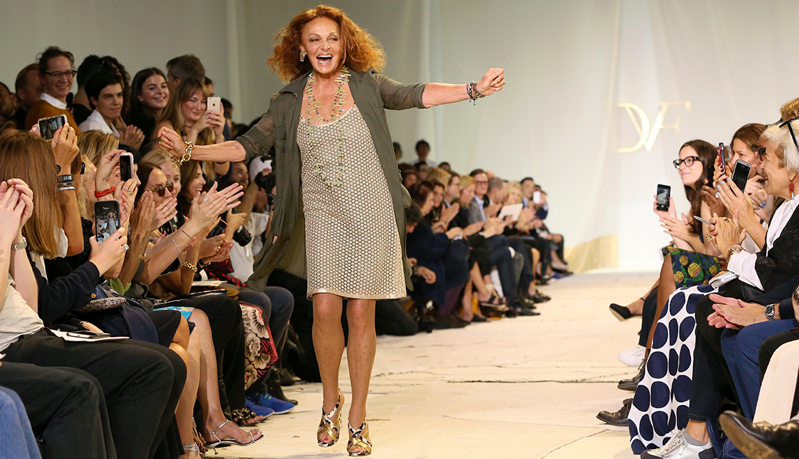diane voon furstenberg walks down runway with arms outstretched