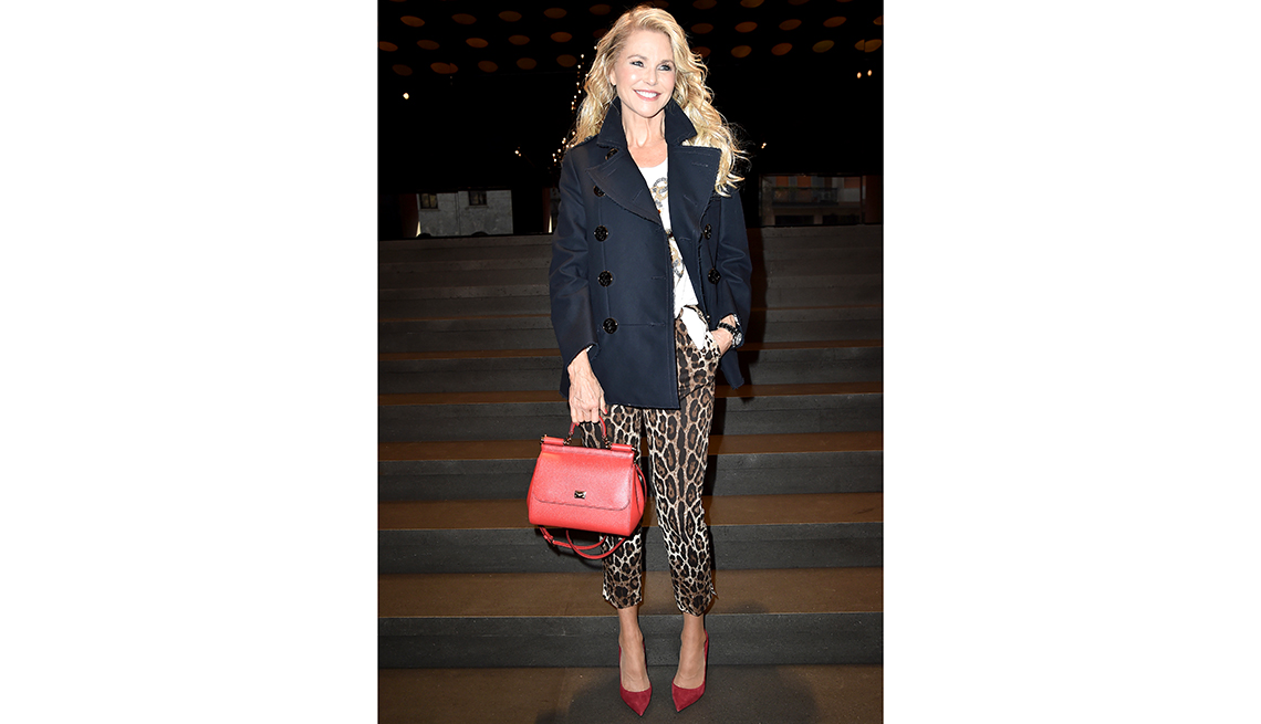 item 7 of Gallery image - christie brinkley wearing leopard pants and red shoes, posing for photographers