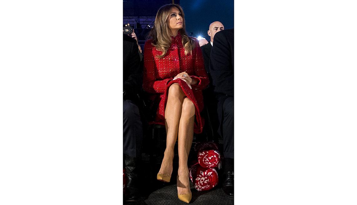 item 6 of Gallery image - melania trump sitting with legs crossed