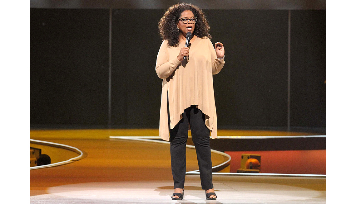 item 9 of Gallery image - oprah winfrey holding a microphone and talking on stage