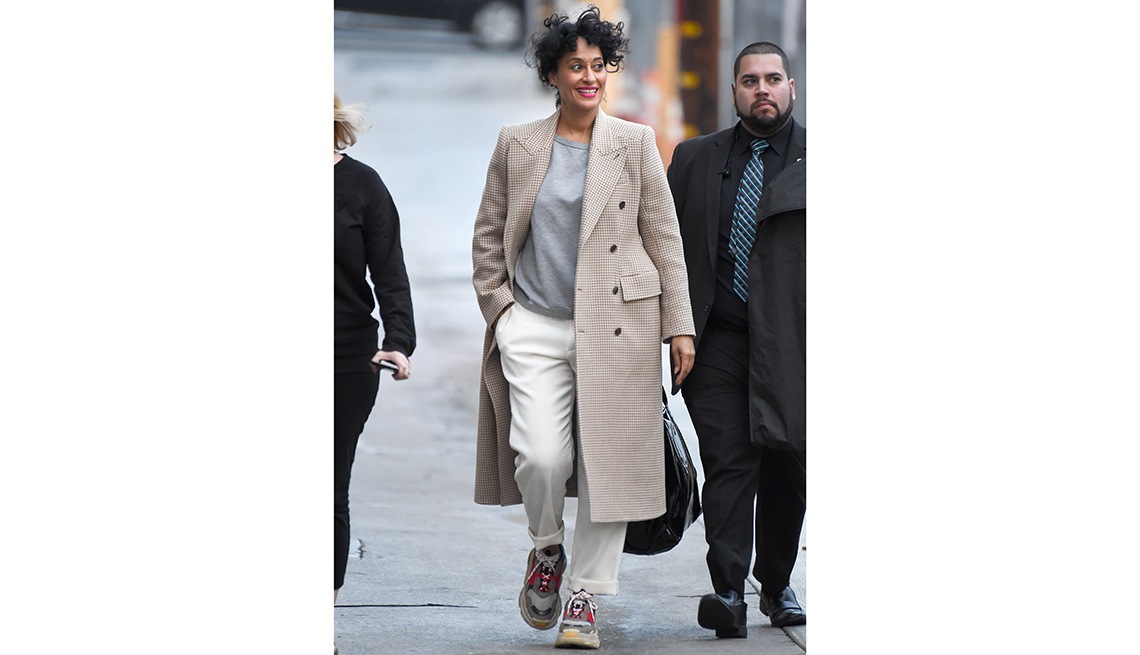 item 2 of Gallery image - tracee ellis ross walks with two other people, smiling with one hand in pocket
