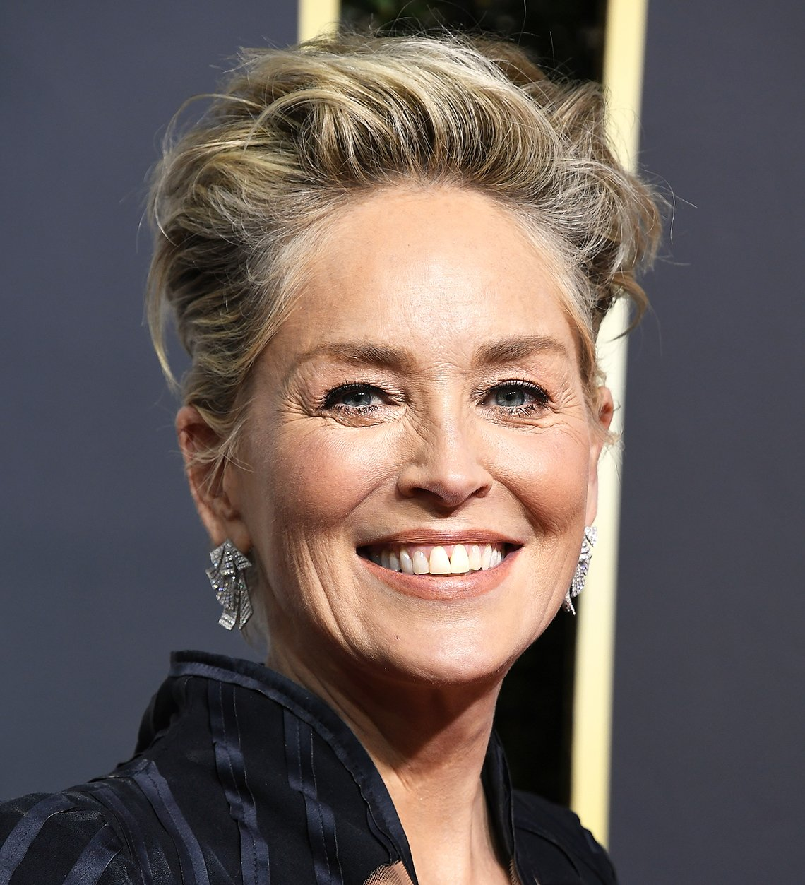 actress sharon stone smiling on the red carpet