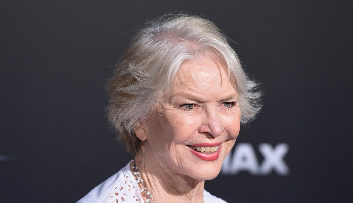 Ellen Burstyn with short grey hair smiling