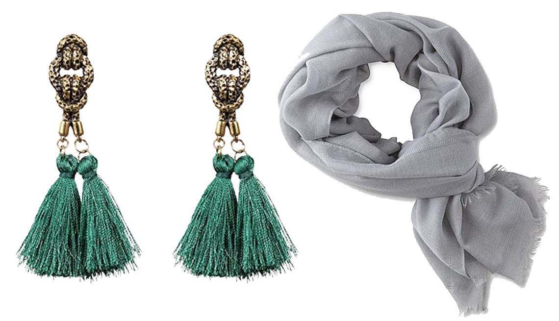 Green earrings and a grey scarf.